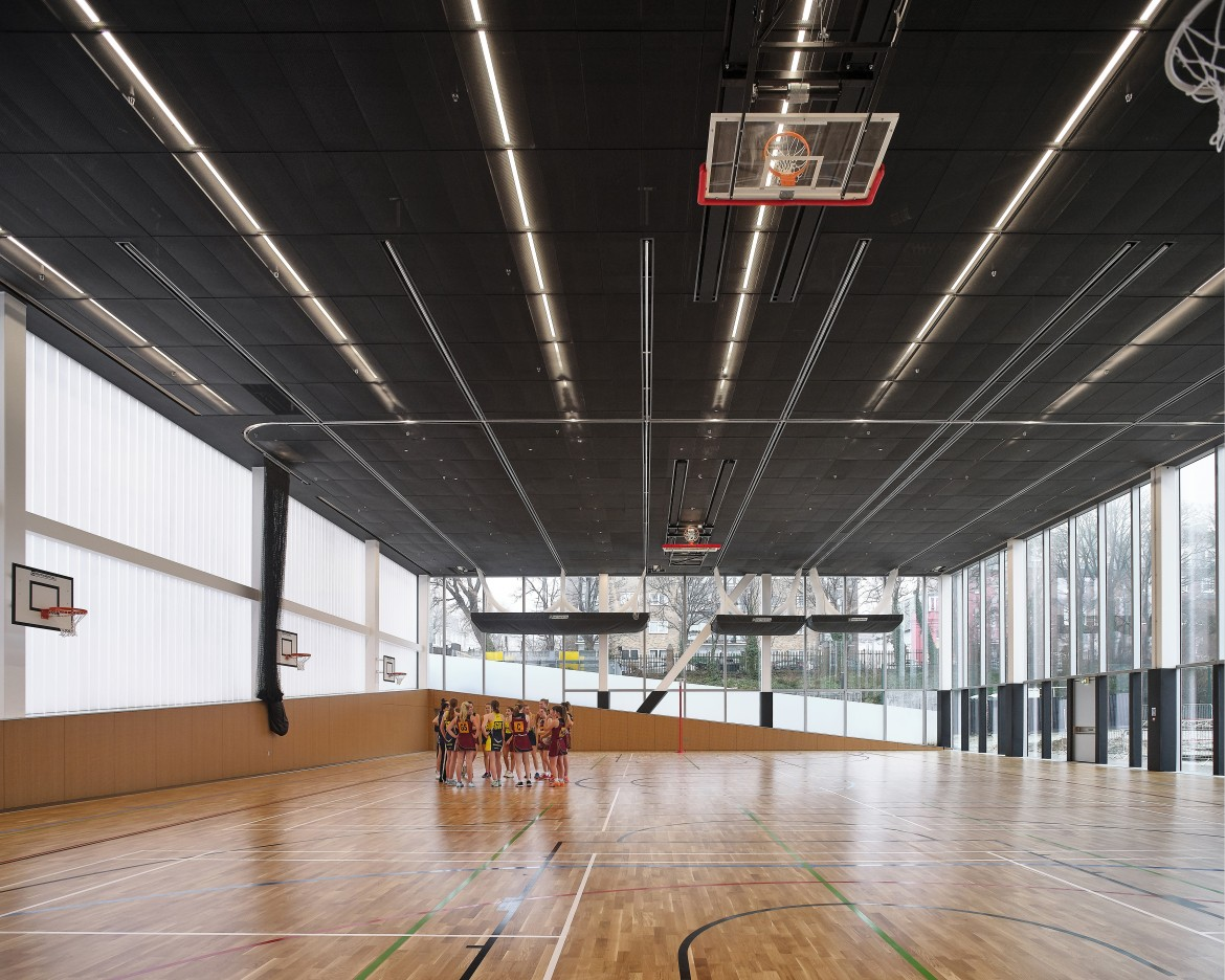 Multi-functional triple-height gymnasium. Brighton College, Brighton, United Kingdom. Architect: OMA, 2020.